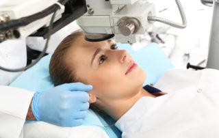 woman gets eye examination